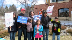 Amy and Francisco Aguirre, pictured here with their five children at a 2013 rally in Bozeman in support of immigration reform, are board members of the Montana Immigrant Justice Alliance. Francisco Aguirre entered the United States without inspection but became a U.S. citizen a few months ago. Photo courtesy Patricia Decker