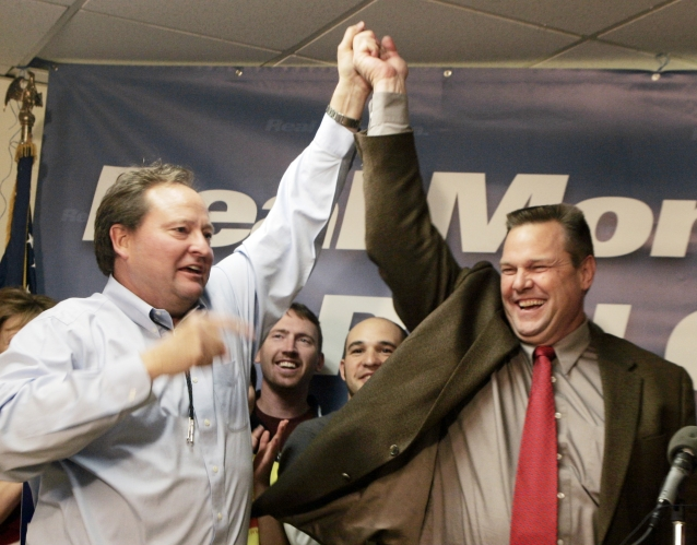 In this Nov. 8, 2006 file photo, Democrat Jon Tester, right, and Montana Gov. Brian Schweitzer celebrate as Tester declares victory in his election battle for the U.S. Senate seat held by incumbent Republican Conrad Burns in Great Falls.  AP Photo/Reed Saxon