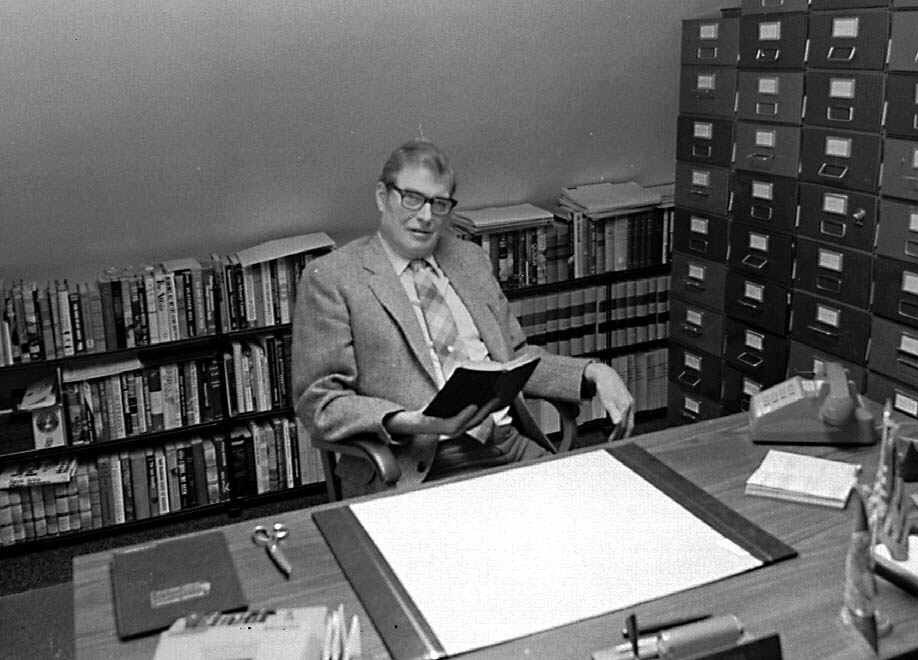 "J.D. Holmes, an influential and respected political writer for The Associated Press, is shown in this undated file photo. Holmes, who covered Montana state government for 30 years, died Sunday, March 21, 1999, in a Helena, Mont., nursing home. That year the Legislature passed a resolution naming the 3rd floor press room in his honor.  Holmes, who retired in 1978, is shown working in the study of his home, flanked on one wall by filing cabinets filled with clippings and other information. He is holding one of his famous ""black books,'' crammed with information about state government. (AP Photo, files)"